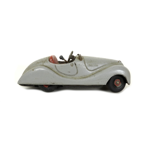 118 - A Schuco Examico 4001, US Zone Germany, in grey with red upholstery, 15 by 6 by 5.5cm, and a Schuco ...