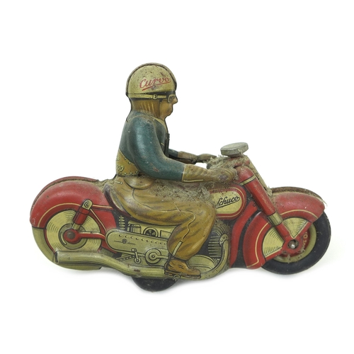 131 - A Schuco Curvo 1000 Motorcycle and rider, Brevete France S.G.D.G. and key, 12.5 by 4.5 by 9.5cm. (2)...