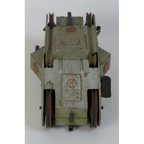 132 - A Louis Marx & Co tin plate clockwork model WWI 'turnover tank' toy, circa 1932, with grey body and ...