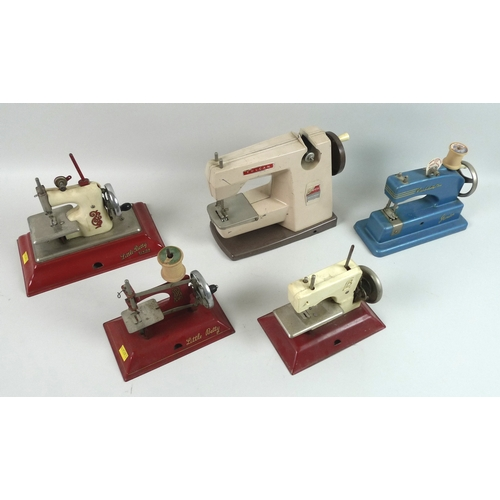 108 - A group of five vintage child's toy sewing machines, three Little Betty, and two Vulcan, largest 18c...