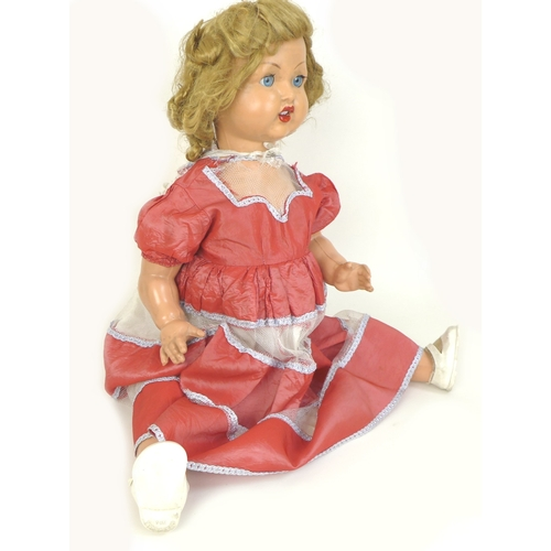 111 - A vintage 1951 Mark Payne walking and talking doll, with wind up mechanism to the stomach, blonde he...