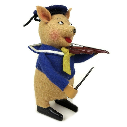 130 - A vintage Shuco tinplate clockwork model of a pig playing the fiddle, dressed in a sailor's uniform,...