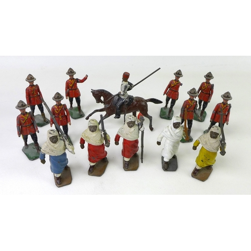 135 - A quantity of Britains lead military figures, comprising comprising eight Royal Canadian Mounted Pol...
