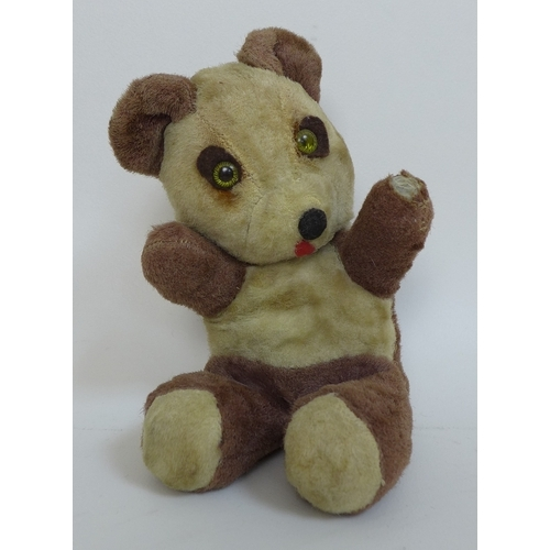 112 - A group of vintage stuffed toys, comprising two teddy bears, a small jointed bear, a panda with gree...