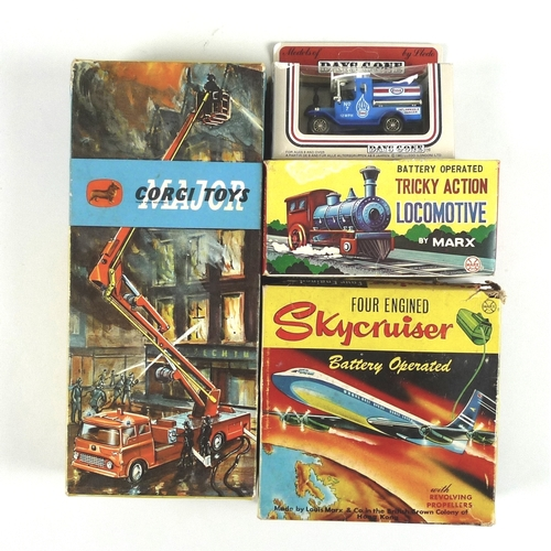 125 - A collection of toys comprising a Corgi Simon Snorkel fire engine, a Louis Marx and Co four engined ...