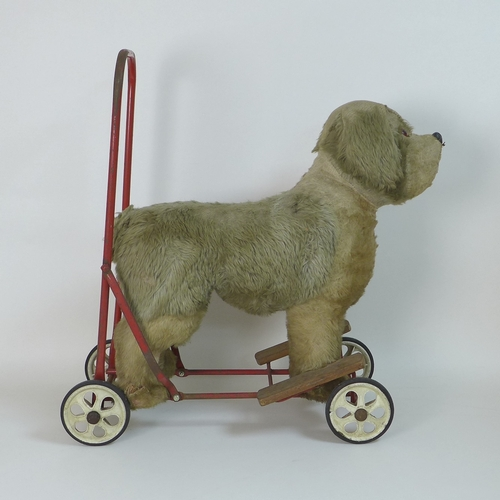 114 - A group of vintage toys comprising a Pedigree Soft Toys Ltd push along ride on dog, 60 by 25 by 61cm...