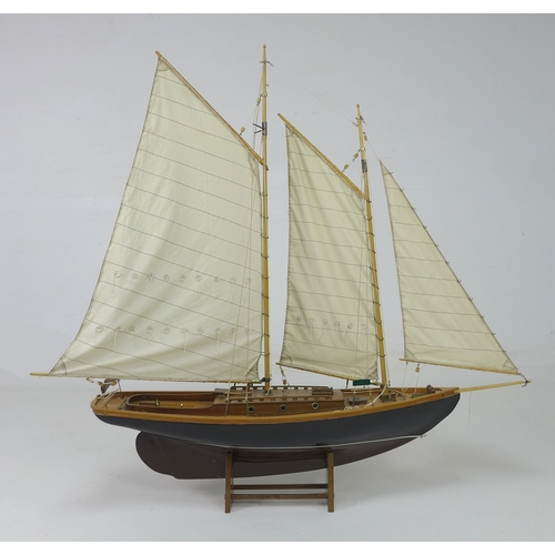 143 - A scratch built model yacht with double masts and gaff rigging, mid 20th century, with black hull, b...