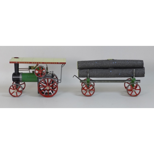 134 - A Mamod Traction Engine, model T.E. 1A Reversing, together with a Mamod Lumber Wagon, model L.W. 1, ...
