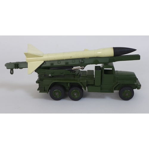 127 - A vintage Dinky Honest John Missile Launcher, model no. 665, in lovely condition, boxed, together wi...