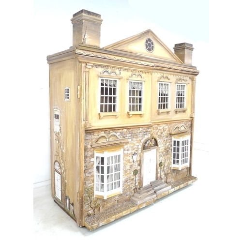 144 - A large and impressive Queen Anne style doll's house, hand made and painted, the pediment above with...