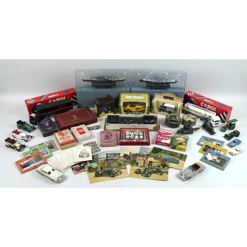 115 - A collection of vintage toys and games, including a Jacques Happy Families card game, a Dinky Bentle...
