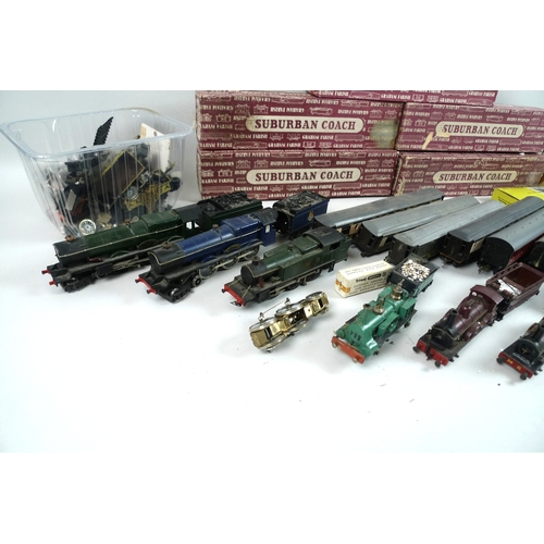 137 - A collection of OO gauge model railway, including seven locos in various states on completion and co...