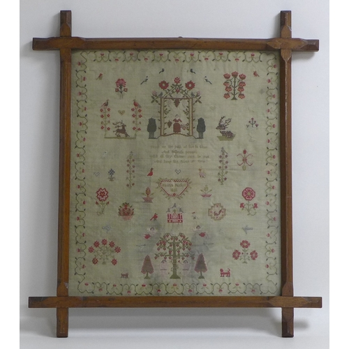 153 - A George IV sampler on linen by Hannah Parker, dated 1828, embroidered with a lady gathering flowers...
