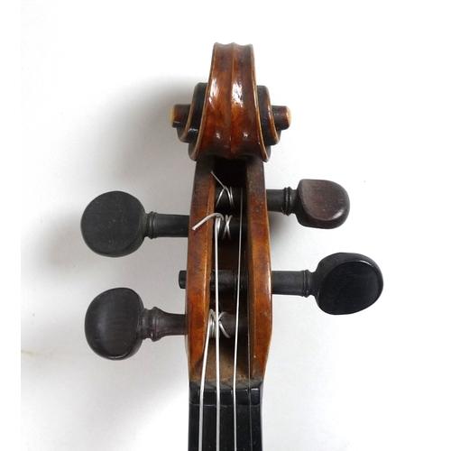 91 - A 19th century German 4/4 violin with label to the interior 'Copy of Antonius Stradivarius', back 35...