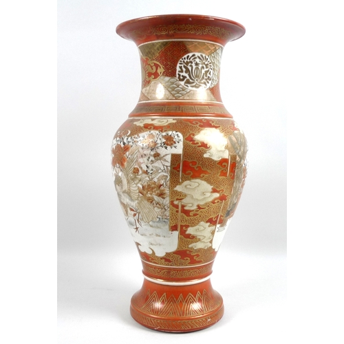 16 - A Japanese Kutani baluster vase, 19th century, decorated in typical style with two birds to one side...