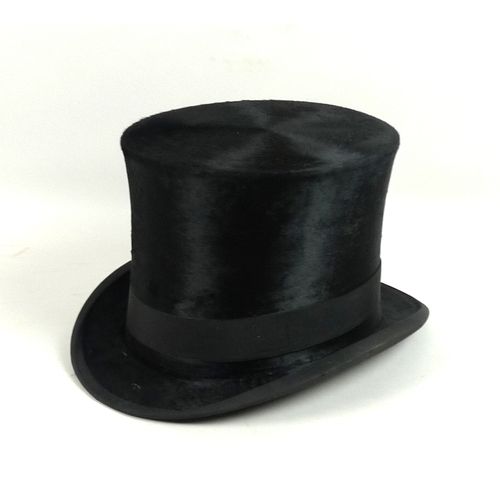 148 - An Edwardian black silk top hat, by hatters A Pellett, Manchester, 55cm internal circumference, 17cm...