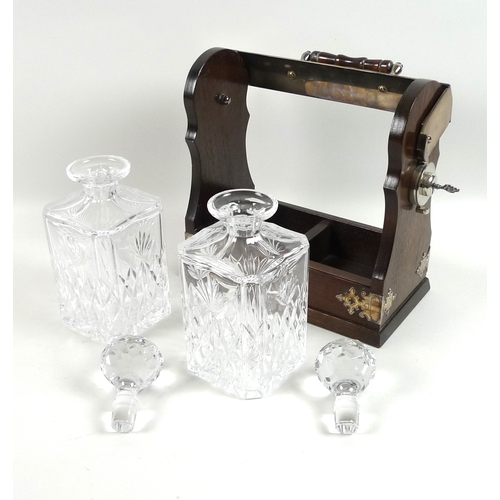 92 - A modern silver plated tantalus, wine pourer and Waterford crystal vase, the lockable mahogany tanta...