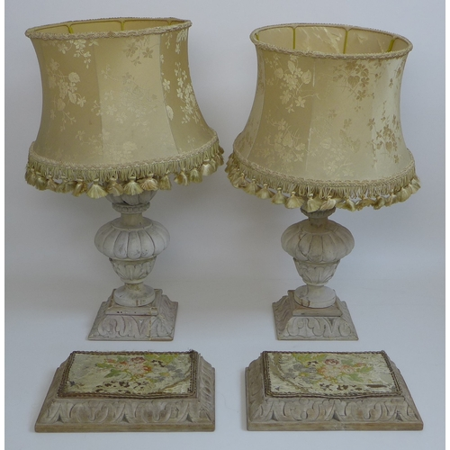226 - A pair of 19th century giltwood carved candlesticks with lobed bases, 16 by 23cm, together with a pa...