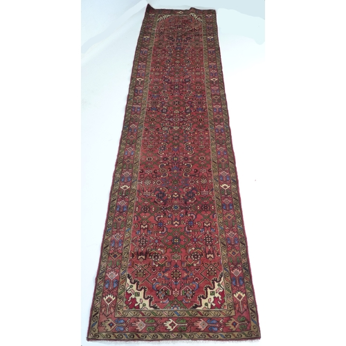 243 - A Hamadan rug with red ground, #5629, 395 by 100cm....