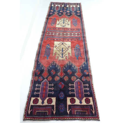 219 - A Hamadan rug with red ground, #5589, 290 by 95cm....