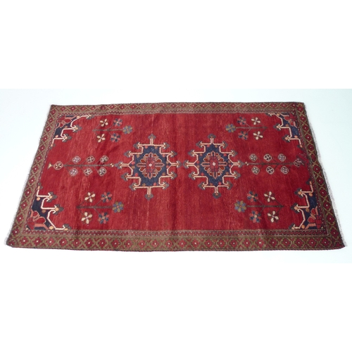 200 - A Baluchi rug with red ground, #5604, 203 by 110cm....