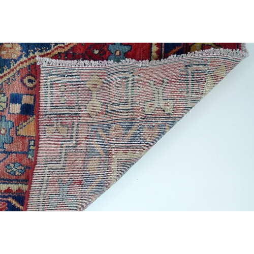 225 - A Hamadan rug with red ground, #5603, 182 by 125cm....