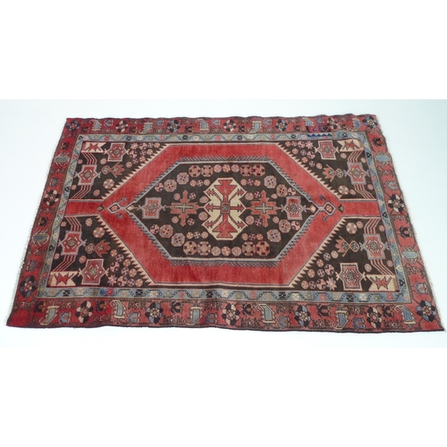 209 - A Hamadan rug with red ground, #5602, 197 by 120cm....