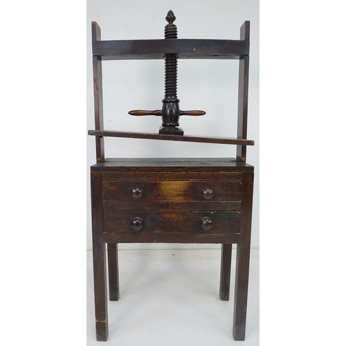 198 - A 19th century oak table top book or linen press with two drawers below, raised on square section le...