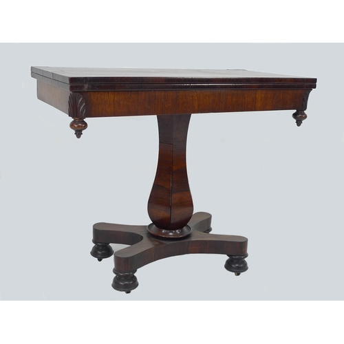 217 - An early Victorian rosewood card table, the rectangular swivel folding top having later green baize ...