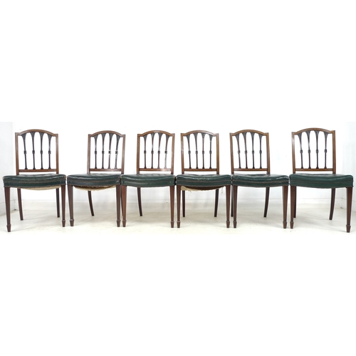258 - A set of six Sheraton style mahogany dining chairs, carved splats to an arched top rail, dark green ...