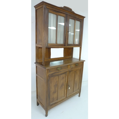 235 - A French 19th century oak dresser, with glazed doors above and two drawers above cupboard below, wit...