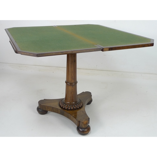 236 - An early Victorian rosewood veneered card table, with cross banding and beading to the edges, green ...