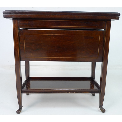 248 - A late 19th or early 20th century rosewood card table with unusual four fold down shelves, marked Tu...