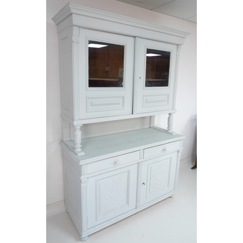 211 - A French white painted oak dresser, with glazed doors enclosing a single shelf above, and two drawer...