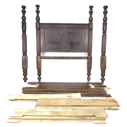 212 - A 19th century four poster bed frame, with reeded and turned supports, approximately 202 by 148 by 2...