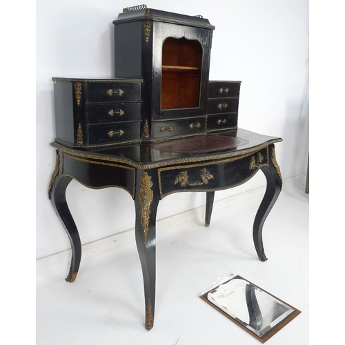 262 - A 19th century French ebonised oak bonheur du jour, with gilt metal applied decoration. 115 by 65.5 ...