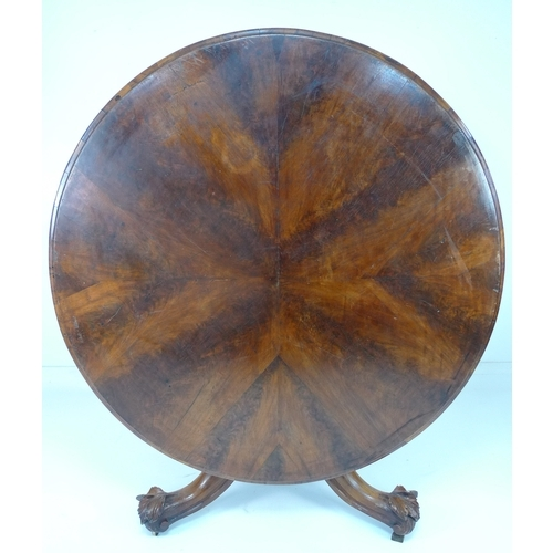242 - A Victorian walnut veneered breakfast table with unusual base, the tilt top on a baluster column and...