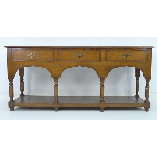260 - A 18th century oak country dresser with low plate rack, 171.5 by 45 by 170cm high....