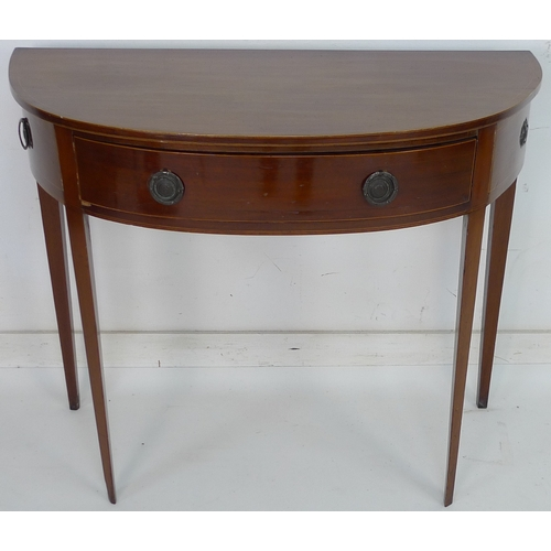 252 - An early 19th century mahogany and line inlaid demi lune side table, single drawer with cast ring ha...