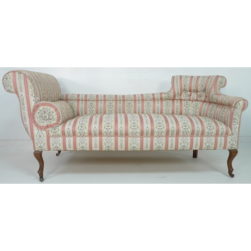 223 - An Edwardian double ended chaise longue, with scroll ends and cabriole front legs with castors, upho...
