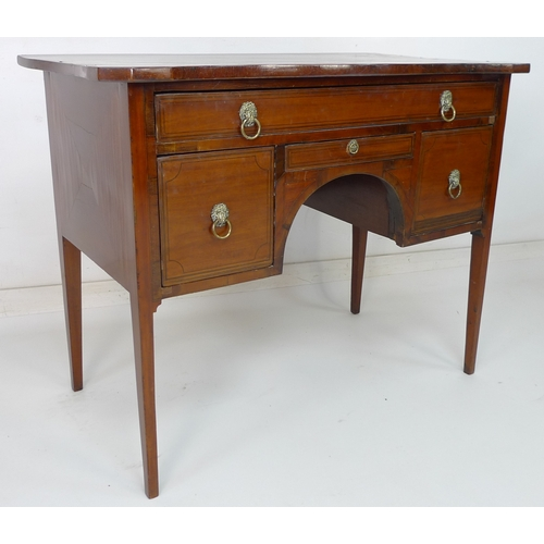 253 - A Regency mahogany and inlaid dressing table, the shaped surface above an arrangement of four drawer...
