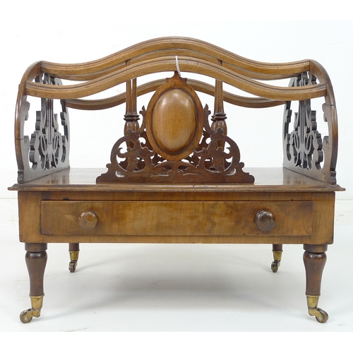 237 - A Victorian walnut veneered Canterbury with lyre pierced sides, oval cartouche with scrolls to front...