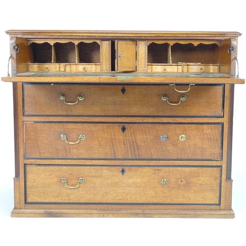 259 - A George III oak secretaire chest of drawers, with fluted quarter columns to the front corners and e...