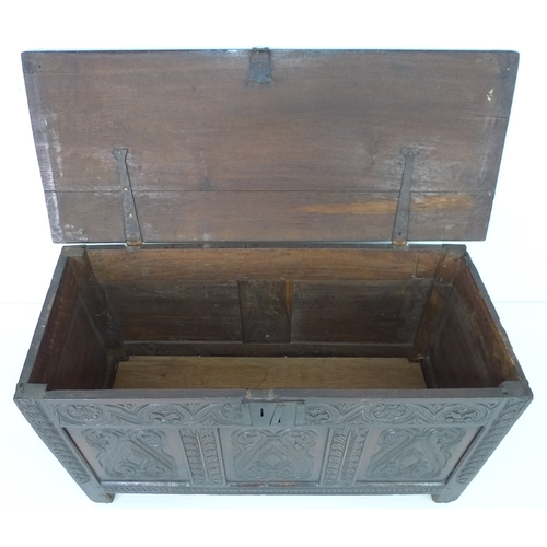 261 - A 17th century oak dower chest, the triple panelled front carved with stylised fleur-de-lys flanked ...