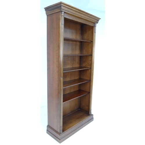 203 - A modern five shelf freestanding bookcase, in the Georgian style with half pilasters to each edge, p...