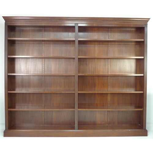220 - A large modern reproduction two division bookcase, in the Georgian style, mahogany veneered, with te...