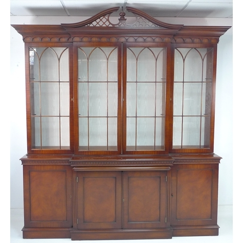 221 - A modern reproduction display bookcase in the Georgian style, mahogany veneered, with pierced swan n...