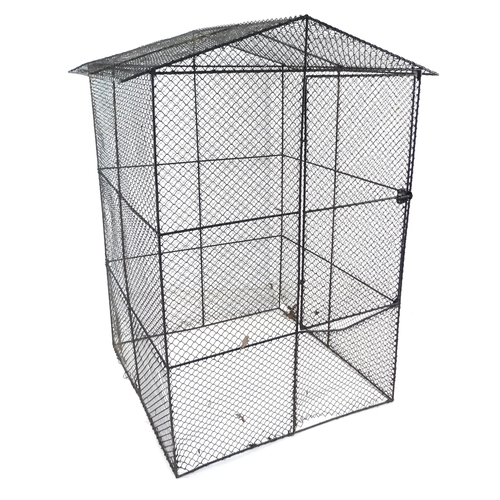 196 - A vintage French garden fruit cage, black painted metal frame and mesh covering, hinged door and pit...