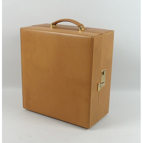 93 - A tan leather picnic case, by Optima, West Sussex, England, fitted interior with space for four cham...