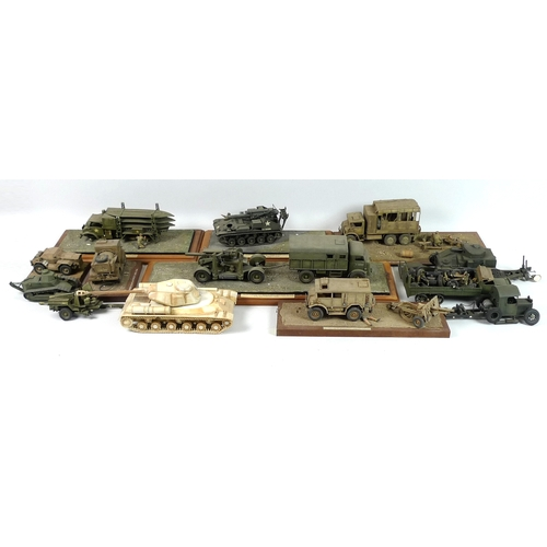 119 - A collection of plastic military models of tanks, anti aircraft guns, trucks and personnel, late 20t...